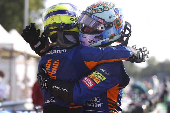 Mclaren driver Daniel Ricciardo of Australia, right, celebrates after with second placed Mclaren driver Lando Norris of Britain after winning the Italian Formula One Grand Prix, at Monza racetrack, in Monza, Italy, Sunday, Sept.12, 2021. (Lars Baron/Pool via AP)