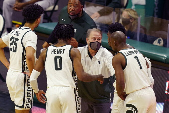 Michigan State head coach Tom Izzo talks to team members during the second half of an NCAA college basketball game against Michigan, Sunday, March 7, 2021, in East Lansing, Mich. (AP Photo/Carlos Osorio)