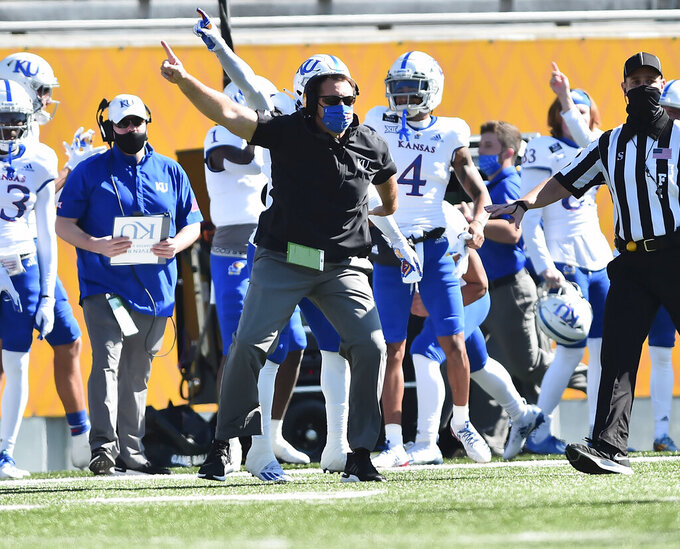Kansas acting head coach Joshua Eargle reacts to a play against West Virginia during an NCAA college football game, Saturday, Oct. 17, 2020, in Morgantown, W.Va. (William Wotring/The Dominion-Post via AP)