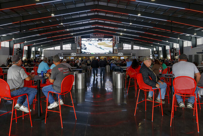 Fans watch the race on a jumbo tron in the new Big Bill's garage and eating area during the Sugarlands Shine 250 at Talladega Superspeedway, Saturday, Oct 12, 2019, in Talladega, Ala. (AP Photo/Butch Dill)