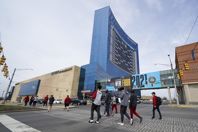 The Arkansas basketball team walks to Victory Field for the NCAA college basketball tournament, Wednesday, March 17, 2021, in Indianapolis. (AP Photo/Darron Cummings)