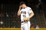 Arizona Diamondbacks pitcher Taylor Clarke pauses after giving up a run to the Miami Marlins during the eighth inning of a baseball game Tuesday, Sept. 17, 2019, in Phoenix. (AP Photo/Matt York)