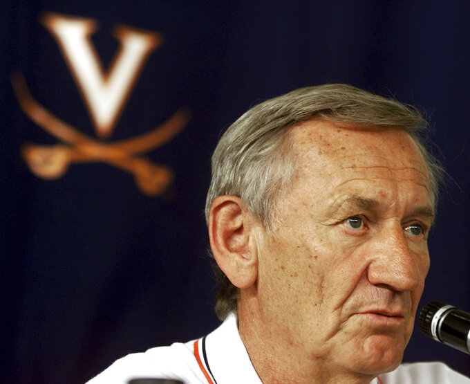 FILE - In this Aug. 11, 2000, file photo, then-Virginia NCAA college football coach George Welsh speaks at a news conference in Charlottesville, Va. Welsh, who coached football at Virginia for 19 years and retired as the Atlantic Coast Conference's career victories leader, has died. The school made the announcement in a release Friday, Jan. 4, 2019, saying Welsh's family says he died peacefully in Charlottesville on Wednesday. He was 85. (AP Photo/Wayne Scarberry, File)