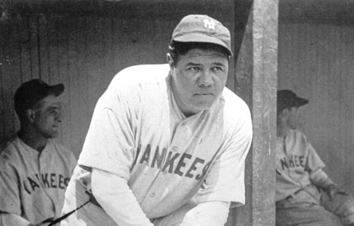 FILE - In this July 1929 file photo, New York Yankees' Babe Ruth, who was injured, stands in the dugout during the baseball team's game at Cleveland. A Babe Ruth road jersey dating to 1928-30 has sold at auction for $5.6 million. Hunt Auctions, which handled Saturday's sale, says the price breaks a record for the most expensive piece of sports memorabilia ever sold. A Ruth jersey from 1920 previously sold for $4.4 million. (AP Photo, File)