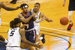 Liberty's Chris Parker, center, passes the ball away from Missouri's Mitchell Smith, left, and Javon Pickett during the first half of an NCAA college basketball game Wednesday, Dec. 9, 2020, in Columbia, Mo. (AP Photo/L.G. Patterson)
