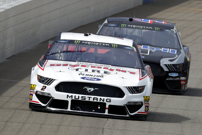 Brad Keselowski leads Kevin Harvick into turn one during a NASCAR Cup Series auto race at Michigan International Speedway in Brooklyn, Mich., Sunday, Aug. 11, 2019. (AP Photo/Paul Sancya)