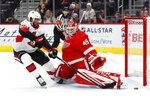 Detroit Red Wings goaltender Jonathan Bernier (45) stops Ottawa Senators left wing Anthony Duclair (10) during a shootout in an NHL hockey game Friday, Jan. 10, 2020, in Detroit. (AP Photo/Paul Sancya)