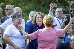 Republican Sen. Michelle Benson, received a hug from her mother Paulette Collins, center, after she announced to launch her campaign for governor, Wednesday, Sept. 1, 2021 in Blaine, Minn. (Elizabeth Flores/Star Tribune via AP)