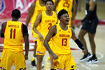Maryland guard Hakim Hart (13) reacts after scoring a basket against Michigan State during the second half of an NCAA college basketball game, Sunday, Feb. 28, 2021, in College Park, Md. Maryland won 73-55. (AP Photo/Julio Cortez)