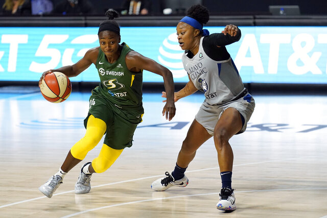 Seattle Storm guard Jewell Loyd (24) drives around Minnesota Lynx guard Odyssey Sims (1) during the second half of Game 2 of a WNBA basketball semifinal round playoff series Thursday, Sept. 24, 2020, in Bradenton, Fla. (AP Photo/Chris O'Meara)