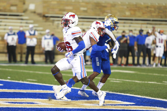 SMU running back Ulysses Bentley IV (26) scores a touchdown against Tulsa during the first half of an NCAA college football game in Tulsa, Okla., Saturday, Nov. 14, 2020. (AP Photo/Joey Johnson)