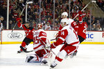 New Jersey Devils center Blake Coleman (20) celebrates scoring a goal past Detroit Red Wings goaltender Jonathan Bernier (45) with Devils center Travis Zajac (19) during the second period of an NHL hockey game Saturday, Nov. 17, 2018, in Newark, N.J. (AP Photo/Adam Hunger)