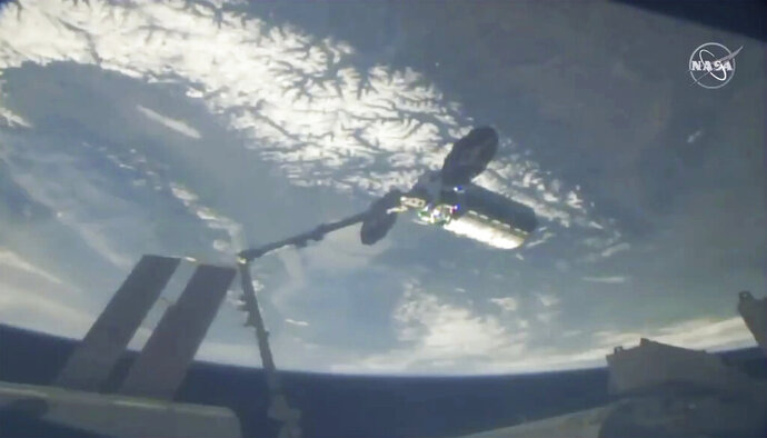 This photo provided by NASA shows a cargo ship arriving at the International Space Station, Friday, April 19, 2019.   Space station astronaut Anne McClain used a robot arm to capture Northrop Grumman's Cygnus capsule as they soared 258 miles (415 kilometers) above France. The Cygnus and its 7,600-pound (3,450-kilogram) shipment rocketed from Wallops Island, Va., on Wednesday, completing the trip in short order.  (NASA via AP)