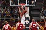 United States' Mason Plumlee dunks near Poland players during a consolation playoff game for the FIBA Basketball World Cup at the Cadillac Arena in Beijing on Saturday, Sept. 14, 2019. U.S. defeated Poland 87-74 (AP Photo/Ng Han Guan)