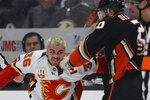 Calgary Flames center Zac Rinaldo, left, and Anaheim Ducks left wing Nicolas Deslauriers fight during the first period of an NHL hockey game in Anaheim, Calif., Thursday, Feb. 13, 2020. (AP Photo/Chris Carlson)