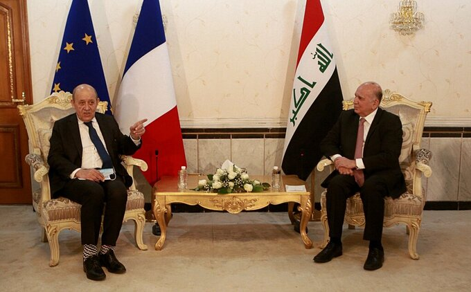 Iraqi Foreign Minister Fouad Hussein, right, meets with visiting French counterpart Jean-Yves Le Drian, in Baghdad, Iraq, Thursday, July 16, 2020. (AP Photo/Hadi Mizban)