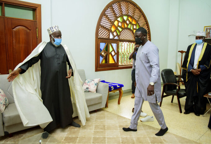 Senegalese - American performer Akon, right, is welcomed by the Mufti of Uganda, Shiekh Shaban  Mubajje, at the Gaddafi National mosque, in Kampala, Uganda, Friday, April 2, 2021. Akon is visiting Uganda Friday in search of investment opportunities that would extend his business footprint in Africa, where his efforts include a planned futuristic city in his native Senegal. Akon's arrival in the East African country was announced by the Ministry of Foreign Affairs. (AP Photo/ Nicholas Bamulanzeki)