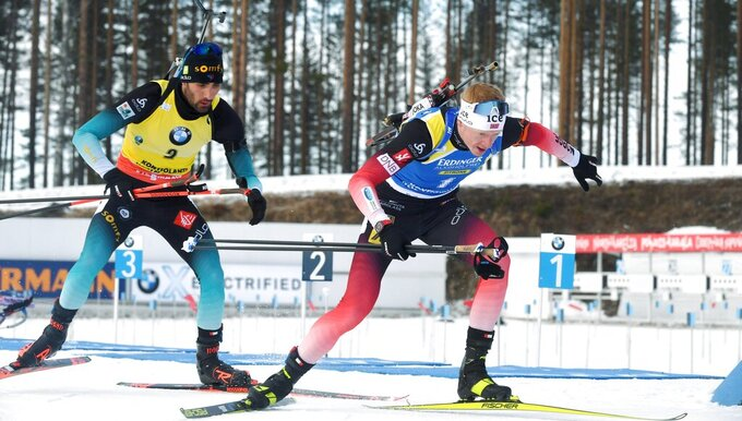 Martin Fourcade, left of France and Johannes Thingnes Boe of Norway compete during the men's 12,5 km Pursuit competition, at the IBU Biathlon World Cup in Kontiolahti, Finland, Saturday March 14, 2020. (Jussi Nukari/Lehtikuva via AP)