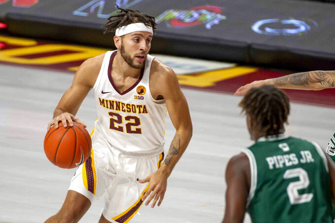 FILE - In this Nov. 25, 2020, file photo, Minnesota guard Gabe Kalscheur dribbles against Green Bay in the first half of an NCAA college basketball game in Minneapolis. Kalscheur has announced he is transferring to Iowa State for his senior season. He is the first of several expected departures from the Gophers following their coaching change.  (AP Photo/Bruce Kluckhohn, File)
