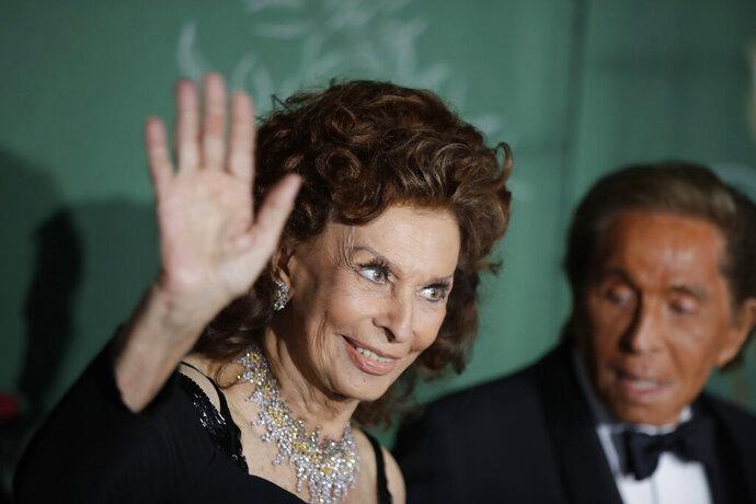 Actress Sophia Loren, left, and designer Valentino Garavani pose for photographers upon arrival at the Green Carpet Fashion Awards in Milan, Italy, Sunday, Sept. 22, 2019. (AP Photo/Luca Bruno)