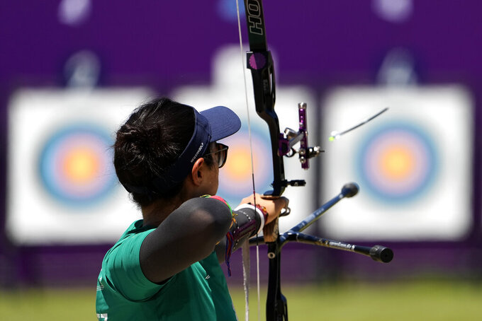 Ana Vazquez, from Mexico, shoots during practice for the 2020 Summer Olympics at Yumenoshima Park Archery Field, Sunday, July 18, 2021, in Tokyo. (AP Photo/Charlie Riedel)