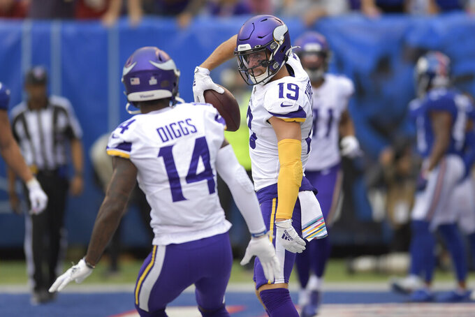 Minnesota Vikings wide receiver Adam Thielen (19) celebrates with wide receiver Stefon Diggs (14) after scoring a touchdown against the New York Giants during the second quarter of an NFL football game, Sunday, Oct. 6, 2019, in East Rutherford, N.J. (AP Photo/Bill Kostroun)