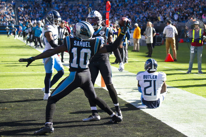 Carolina Panthers wide receiver Curtis Samuel (10) celebrates his touchdown against the Tennessee Titans as cornerback Malcolm Butler (21) sits on the turf during the first half of an NFL football game in Charlotte, N.C., Sunday, Nov. 3, 2019. (AP Photo/Mike McCarn)