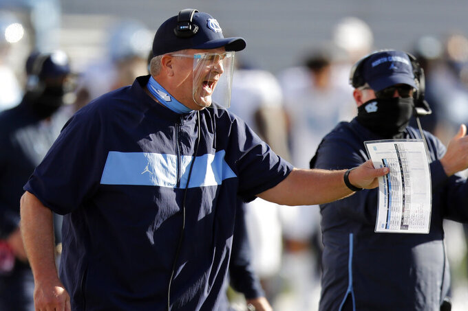 North Carolina head coach Mack Brown reacts after his team scored during the first half of an NCAA college football game against Boston College, Saturday, Oct. 3, 2020, in Boston. (AP Photo/Michael Dwyer)