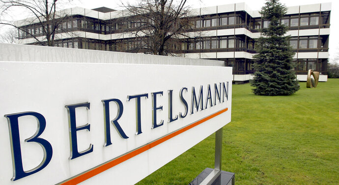 FILE -- This March 13, 2003 file photo shows an exterior view of the German media giant Bertelsmann in Guetersloh, Germany. German media giant Bertelsmann said Wednesday that it is buying publisher Simon & Schuster from ViacomCBS for $2.17 billion in cash. (AP Photo/Michael Sohn, file)