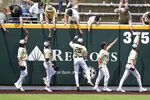 Vanderbilt players celebrate with fans after beating East Carolina in an NCAA college baseball super regional game Saturday, June 12, 2021, in Nashville, Tenn. Vanderbilt won 4-1 to sweep the three-game series and advance to the College World Series. (AP Photo/Mark Humphrey)