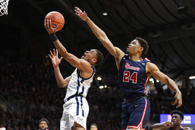 Butler guard Aaron Thompson (2) shoots in front of St. John's guard Nick Rutherford (24) during the first half of an NCAA college basketball game in Indianapolis, Wednesday, March 4, 2020. (AP Photo/Michael Conroy)