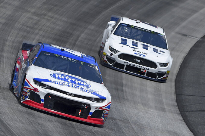Ryan Preece (47) leads Brad Keselowski (2) during the NASCAR Cup Series auto race, Monday, May 6, 2019, at Dover International Speedway in Dover, Del. (AP Photo/Will Newton)