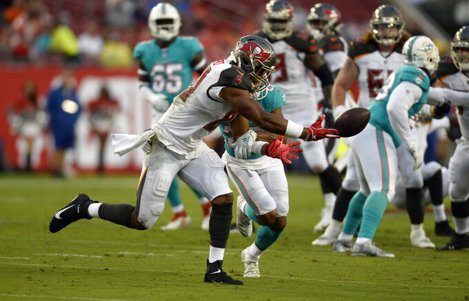 Tampa Bay Buccaneers tight end O.J. Howard (80) can't hang onto a pass as he is tied up by Miami Dolphins free safety Minkah Fitzpatrick (29) during the first half of an NFL preseason football game Friday, Aug. 16, 2019, in Tampa, Fla. (AP Photo/Jason Behnken)