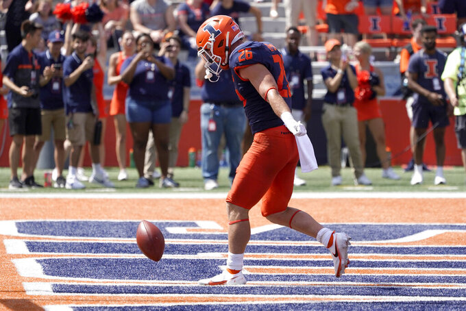 Illinois running back Mike Epstein celebrates his touchdown during the first half of an NCAA college football game against the Nebraska Saturday, Aug. 28, 2021, in Champaign , Ill. (AP Photo/Charles Rex Arbogast)