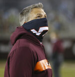 Virginia Tech coach Justin Fuente waits for the team's NCAA college football game against Virginia on Saturday, Dec. 12, 2020, in Blacksburg, Va. (Matt Gentry/The Roanoke Times via AP, Pool)