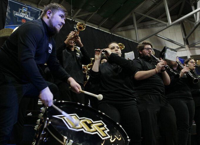 The UCF band plays during a first round women's college basketball game against Arizona State, in the NCAA Tournament in Friday, March 22, 2019, in Coral Gables, Fla. (AP Photo/Luis M. Alvarez)