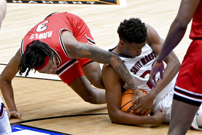 St. Mary's forward Judah Brown (25) takes the ball away from Western Kentucky guard Jordan Rawls (3) in the first half of an NCAA college basketball game in the first round of the NIT, Wednesday, March 17, 2021, in Frisco, Texas. (AP Photo/Matt Strasen)