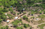 In this photo taken Wednesday, Aug. 28, 2019, an opposition military camp is seen from the air near the town of Nimule in Eastern Equatoria state, South Sudan. South Sudan's fragile peace deal is faltering Wednesday Oct. 16, 2019, less than one month before the country's president and armed opposition leader are meant to form a unity government and begin the long recovery from a five-year civil war. (AP Photo/Sam Mednick)