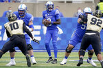 Kentucky quarterback Terry Wilson (3) scrambles with the ball during the second half of an NCAA college football game against Vanderbilt, Saturday, Nov. 14, 2020, in Lexington, Ky. (AP Photo/Bryan Woolston)