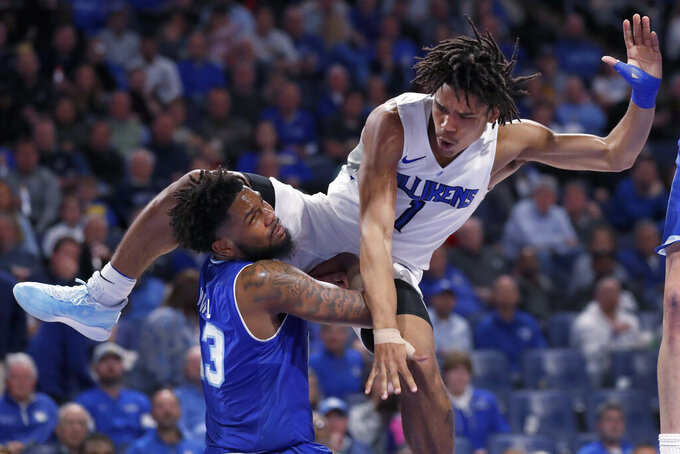Saint Louis' Yuri Collins (1) collides with Seton Hall's Myles Powell (13) while heading to the basket during the second half of an NCAA college basketball game Sunday, Nov. 17, 2019, in St. Louis. Seton Hall won 83-66. (AP Photo/Jeff Roberson)