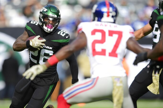 New York Giants cornerback Deandre Baker (27) chases down New York Jets' Le'Veon Bell (26) during the first half of an NFL football game Sunday, Nov. 10, 2019, in East Rutherford, N.J. (AP Photo/Steven Ryan)