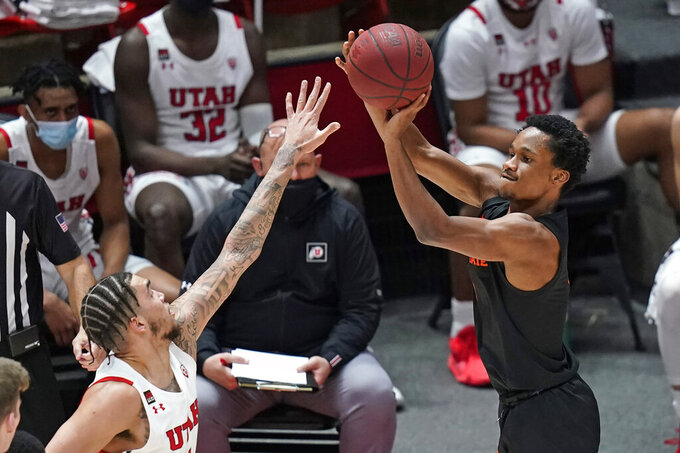 Oregon State guard Gianni Hunt, right, shoots as Utah forward Timmy Allen defends during the first half of an NCAA college basketball game Wednesday, March 3, 2021, in Salt Lake City. (AP Photo/Rick Bowmer)