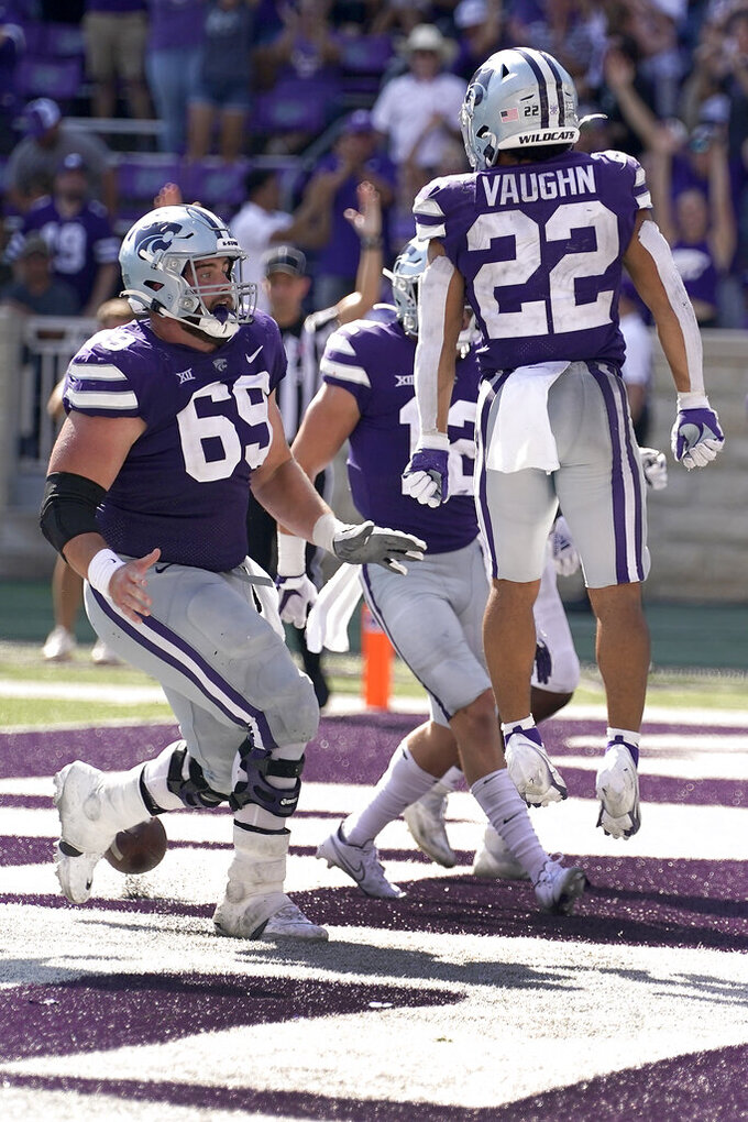 Kansas State running back Deuce Vaughn (22) celebrates with teammates after scoring a touchdown during the second half of an NCAA college football game against Nevada on Saturday, Sept. 18, 2021, in Manhattan, Kan. (AP Photo/Charlie Riedel)
