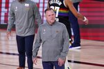 Denver Nuggets head coach Michael Malone walks onto the court during a time out in the second half of Game 3 of the NBA basketball Western Conference final against the Los Angeles Lakers on Tuesday, Sept. 22, 2020, in Lake Buena Vista, Fla. (AP Photo/Mark J. Terrill)