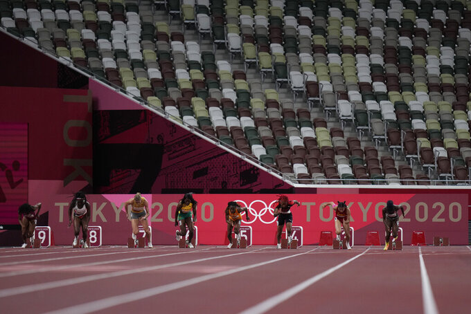 Marie-Josee Ta Lou, of Ivory Coast, wins a women's 100-meter semifinal at the 2020 Summer Olympics, Saturday, July 31, 2021, in Tokyo. (AP Photo/Petr David Josek)