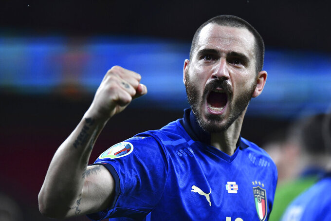 Italy's Leonardo Bonucci celebrates end of the Euro 2020 soccer championship round of 16 match between Italy and Austria at Wembley stadium in London in London, Saturday, June 26, 2021. (Ben Stansall/Pool Photo via AP)