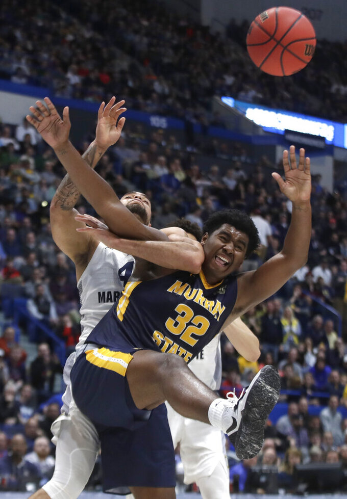 Murray State's KJ Williams (23) and Marquette's Theo John, behind, battle for a rebound during the second half of a first round men's college basketball game in the NCAA Tournament, Thursday, March 21, 2019, in Hartford, Conn. (AP Photo/Elise Amendola)
