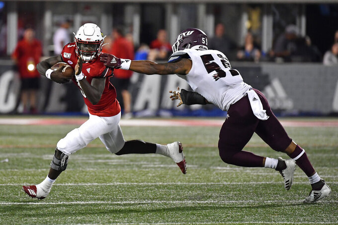 Louisville quarterback Malik Cunningham (3) runs from the grasp of Eastern Kentucky defensive end Taquan Evans (55) during the second half of an NCAA college football game in Louisville, Ky., Saturday, Sept. 7, 2019. (AP Photo/Timothy D. Easley)