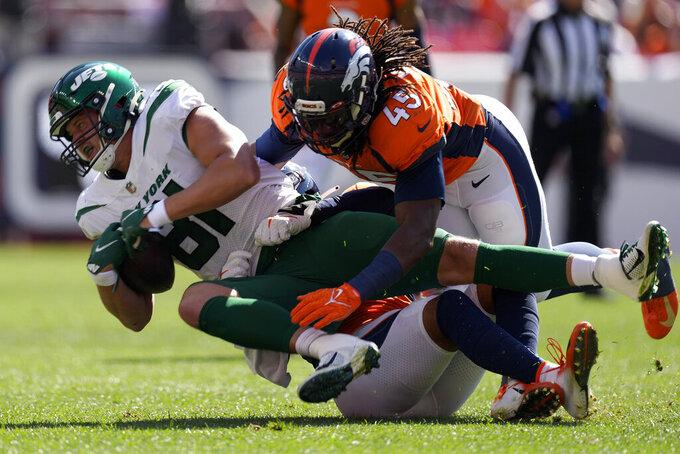 Denver Broncos linebacker A.J. Johnson (45) tackles New York Jets tight end Tyler Kroft (81) during the first half of an NFL football game, Sunday, Sept. 26, 2021, in Denver. (AP Photo/David Zalubowski)