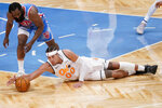 Brooklyn Nets guard James Harden (13) and Orlando Magic forward Aaron Gordon (00) vie for a loose ball during the first half of an NBA basketball game, Saturday, Jan. 16, 2021, in New York. (AP Photo/Mary Altaffer)